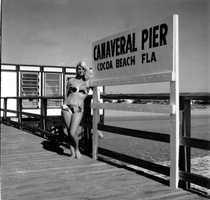 1970: Woman in bikini posing at Canaveral Pier