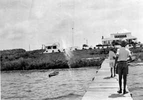 1937: View looking toward the Mosquito Lagoon House of Refuge from dock on the Indian River lagoon at John Bartram State Park