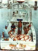 "1979: Men aboard Jack Sapp's ""Sea Flea"" with a large catch of snapper in New Smyrna Beach."