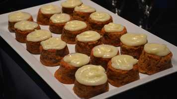 Fresh baked carrot cake with Craisins and cream cheese icing, found at the Hops and Barley marketplace.