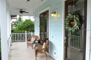 Wrap around porch welcomes you inside.