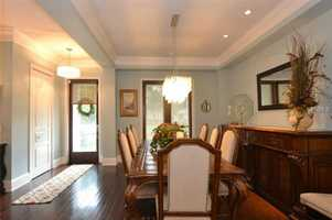 This formal dining room is traditional with a flare.