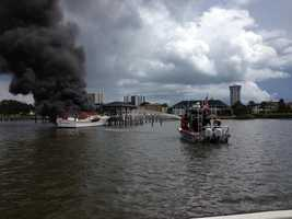 A boat caught fire as it was on its way to its new owners in Daytona Beach on Tuesday.