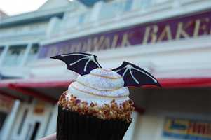 Our friends at the Disney Parks Blog show us where you can find these spooky Halloween treats at Disney.This bat cupcake with vanilla cake with caramel apple filling, topped with whipped cream can be found at the Boardwalk Bakery