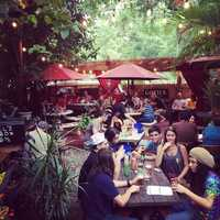 4. Yellow Dog EatsWhere: 1236 Hempel Ave., Windermere, FL 34786Stop by and visit chef Fish Morgan in his restaurant that was formally an 100-year-old country store. The patio is in the middle of a huge garden where live music, trivia and Karaoke takes place. There is a large beer and wine selection, but if it's food you want, we suggest the Drunken Pig. It's tender pulled pork topped with pecan smoked bacon, Gauda cheese, crispy fried onions, Fish's Gold BBQ sauce and smothered with homemade beer-cheese soup.