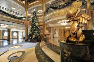 "Holidays are magical aboard the Disney Fantasy with a nearly three-deck tall tree in the atrium lobby. In the spirit of holiday cheer, Disney Cruise Line adds sparkle to each ship during Very Merrytime Cruises, with special stem-to-stern holiday events, traditional ""turkey day"" fanfare, Christmas feasts, ""snow flurries"" and New Year's Eve galas."