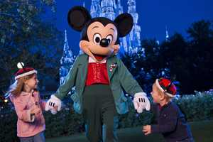 """Mickey Mouse presides over the holiday festivities during Mickey's Very Merry Christmas Party. The celebration will showcase special entertainment, including """"Mickey's Once Upon a Christmastime Parade"""" and a holiday edition of the fireworks spectacular """"Wishes,"""" as well as meet-and-greet opportunities with favorite Disney characters in holiday attire."""