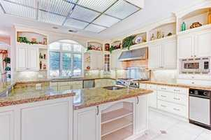 Last but not least, the open kitchen is illuminated by immense natural light.