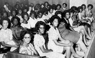 Photographed here is a part of the 220 African American students who more than filled a circuit courtroom to face charges on May 31, 1963 for demonstrating against segregated movie theaters.