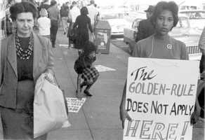 Boycott and picketing of downtown stores in Tallahassee on Dec. 6, 1960. The boycott and picketing was done because of a lack of progress in desegregating the lunch counters at Neisner's McCrory's, F.W. Woolworth's, Walgreen's and Sear's stores.