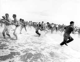 """Segregationists trying to prevent blacks from swimming at a """"White only"""" beach in St. Augustine on June 25, 1964."""