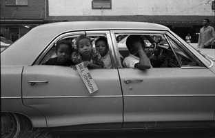 """Unidentified children holding a """"Free Bill Johnson political prisoner"""" bumper sticker at rally in Frenchtown in Tallahassee on July 31, 1971."""