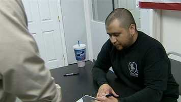 8. George Zimmerman signs autographs at Orlando gun show - George Zimmerman was shaking hands, smiling and signing autographs at a central Florida gun show. (Read Story)