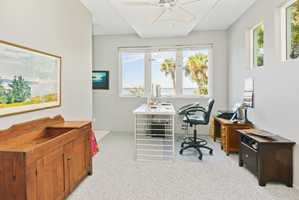 Executive office with beautiful desk.