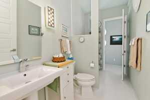 This bathroom is less extravagant but still boasts stylish, modern influences.