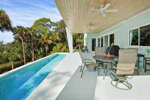 A long, lap pool on the deck's edge.