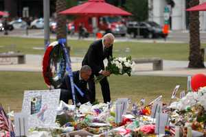 President Barack Obama and Vice President Joe Biden lay wreaths at a memorial outside the Dr. Phillips Performing Arts Center