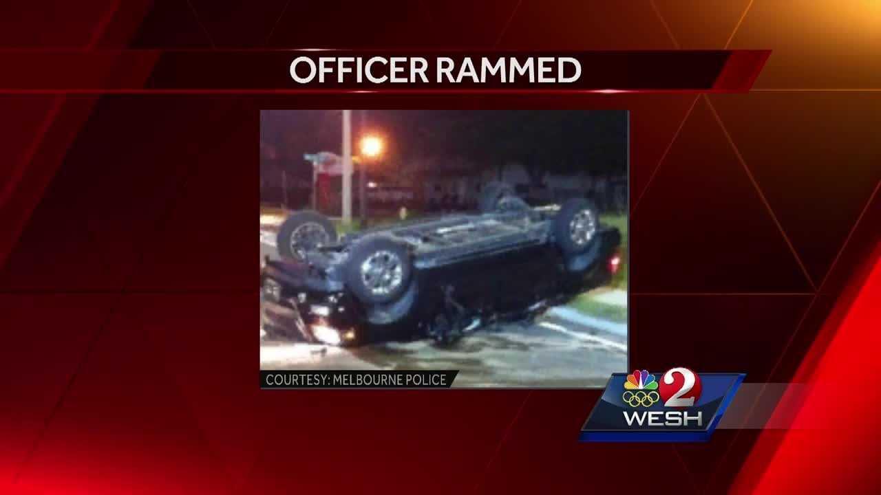 Officer rammed by suspect in stolen truck