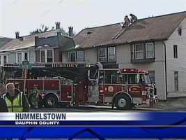 A fire in an apartment building in Hummelstown, Dauphin County, Wednesday morning trapped a woman on the second floor.