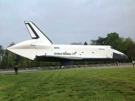 Thousands of visitors got an up close look at the Space Shuttle Discovery as it was towed to its new home at the Smithsonian's National Air and Space Museum Annex in near Dulles International Airport in northern Virginia.