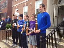 Runners get their trophies in the York Race Against Racism.