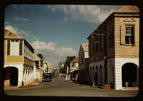 The main shopping street of Christiansted, Saint Croix, Virgin Islands. Jack Delano took this photo in December 1941.