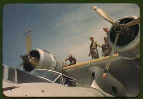 Working on a plane at the Naval Air Base in Corpus Christi, Texas. Howard R. Hollem took this photo in August 1942.