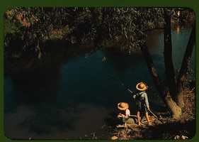Boys fishing in a bayou near a school in Schriever, La.Marion Post Wolcott took this image in June 1940.