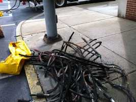 Crews pulled these burned cables from underground and are replacing them.