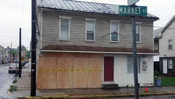 A 70-year-old woman crashed her car into a Mechanicsburg business on Saturday morning.