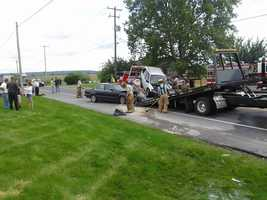 A silver vehicle was stopped westbound to make a turn, a black car rear-ended that vehicle and the silver vehicle then struck a tractor-trailer traveling eastbound. Two people in the silver vehicle were taken to Lancaster General Hospital. One person in the car was treated at the scene and the truck driver was not injured.