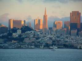 3. San Francisco, California: San Francisco is renowned for its chilly summer fog, steep rolling hills, mix of Victorian and modern architecture, and its famous landmarks that include the Golden Gate Bridge, cable cars, and Chinatown.