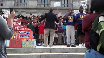 Hundreds of children rallied Wednesday at the state Capitol against proposed school funding cuts.