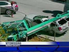 A woman's SUV was nearly cut in half after a boom lift fell on top of it Wednesday at the Vanity Fair Outlet in Wyomissing, Berks County.