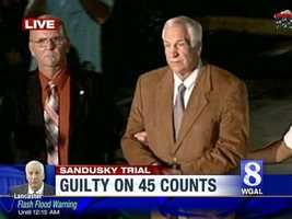 Jerry Sandusky leaves the courthouse in shackles as a guilty verdict is returned on 45 of 48 charges.