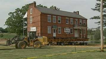 Moving the home about 300 feet to its new location will take about 6 hours.