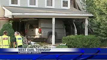 A pickup truck crashed into a house Thursday evening at the intersection of Locust Street and Elizabeth Avenue in West Earl Township, Lancaster County.