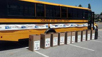 "Project SHARE in Carlisle is hosting a ""Stuff the Bus"" event at the Walmart parking lot until 7 p.m. Wednesday."