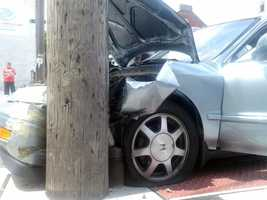 The SUV ran a stop sign at Water Street and struck the car, according to witnesses.