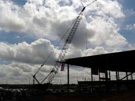 The final beam for the Ann B. Barshinger Cancer Center was lifted into place Monday.