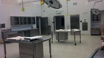 The autopsy rooms have high-tech lights with cameras and microphones built in to record autopsies.