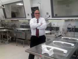 Lancaster County Coroner Dr. Steven Diamantoni stands in an autopsy room.