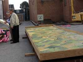 Crews are moving pieces of the electric map that depicts the Battle of Gettysburg into a Hanover building.