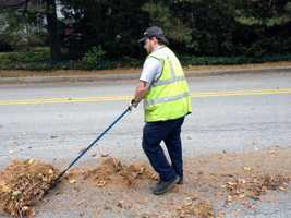 York crews cleaned up leaves Friday ahead of Hurricane Sandy.