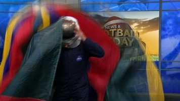 Mike Hostetler does a Fearless Felix Baumgartner impression as he lands in the News 8 Football Friday studio.