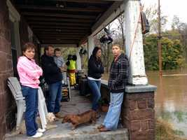 This family's home along Hykes Mill Road is surrounded by water.