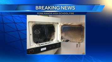 School officials shared this photo of the clothes dryer that caught on fire.