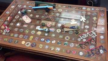 Platts also displays these coins on a glass-topped coffee table. Some of his son's childhood creations rest on top.