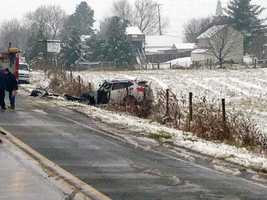 A pickup truck and car collided, pushing the car off the road.