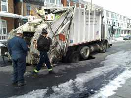 A garbage truck fell part way into the first sinkhole Monday morning around 7:30.